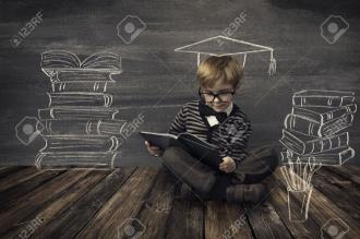 /Files/images/stornka_psihologa_-2017_/39762638-Child-Little-Boy-in-Glasses-Reading-Book-over-School-Black-Board--Stock-Photo.jpg